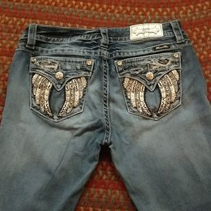Miss Me Signature skinny jeans. Wings/flap pockets